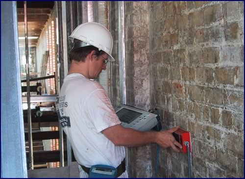 Microwave radar scanning of an historic wall in New Orleans to locate interior voids prior to stabilization.