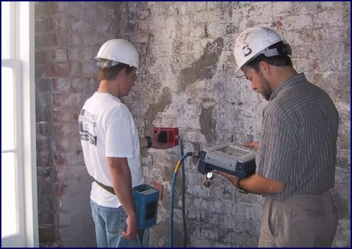 Alan Lockrem and Michael Schuller using radar measurements for quality assurance to evaluate results of a project to stabilize historic masonry involving injection of internal voids with a compatible injection fill (CIF).