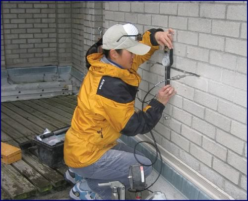 Flatjack test being used to measure masonry compression stresses in situ (Shan Wo, Seattle).