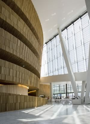 "Oslo Opera House: ""The wave wall,"" which is an oak-clad, interior wall that is the dominant feature of the lobby."