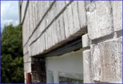 Case #4. Masonry sag and cracks were symptoms caused by inadequate strength of garage entrance steel lintel.