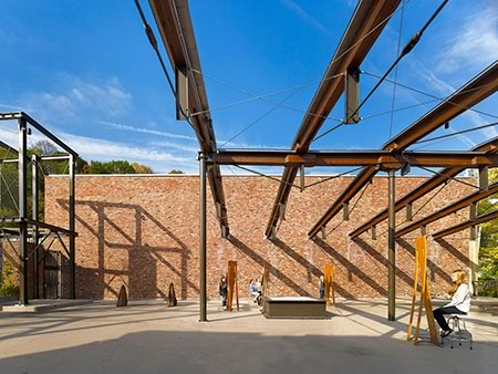 The cleaned and refinished timber structure of the former garage preserved the 'phantom' of the building for visual impact and human scale -- Lafayette College Arts Plaza in Easton, Pa.
