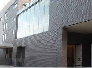 The exterior of the structure includes Endicott IronSpot modular brick and thin brick veneer. Photo: CB Masonry.