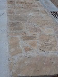 Natural Arkansas Flagstone paving accents the landscape of the hotel and bridges the gap between older construction in the area and new downtown structures. Photo: CB Masonry.