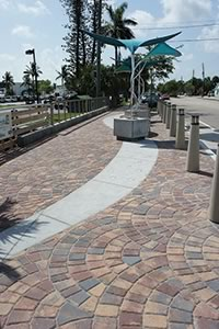 The colorful Belgard pavers used in the project fit right in to the coastal environment and architectural style of Stuart, FL.