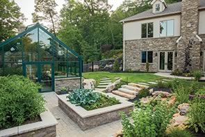 The award winning hardscaping of the Packer Residence includes a green house.