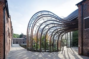 Heatherwick Studio retrofitted an old paper mill into gin-maker Bombay Sapphire's first in-house production facility.