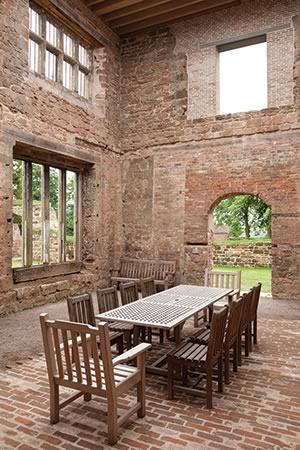 It's easy to see one's family enjoying a meal around the table in this remarkable space at Astley Castle.