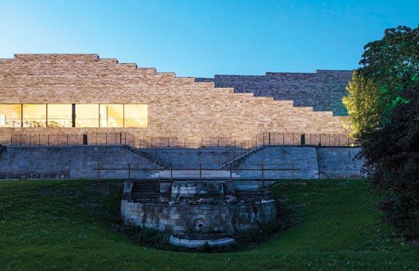 unique exterior walls Grimmwelt Kassel museum reinforced concrete natural stone structure Gauinger Travertin