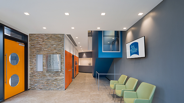 "Michielli + Wyetzner incorporated Sierra Shadowstone on the entry wall as part of the hospital's ""brand."""