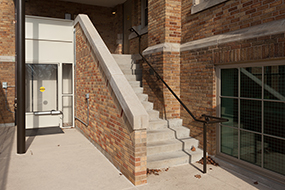 The building's original staircase had to be rebuilt to comply with current codes.