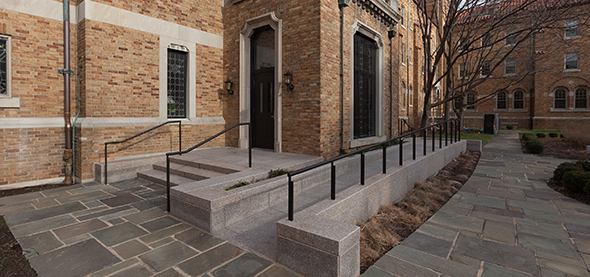 A new ADA-compliant entrance is made of structural masonry accented with granite walls.