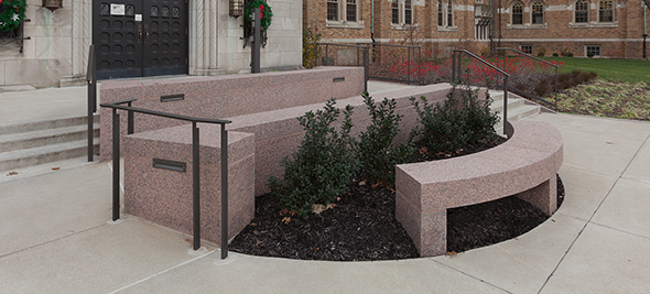 Granite walls and granite bench give the entrance an additional use as a common space.
