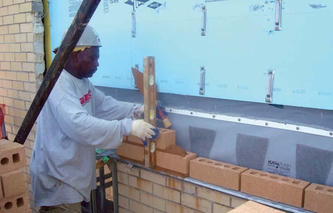 Brick installation over Unitized Flashing System.