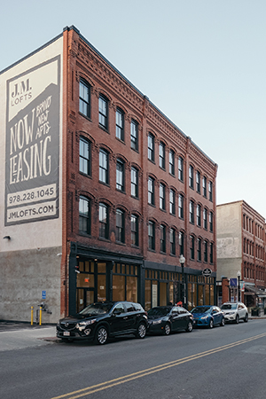 RODE Architects designed the renovation of an old office supply building in Haverhill, Mass., into JM Lofts, a multi-use building containing both housing and retail space, providing residents with a building that matches the tempo of their busy lives. Rendering courtesy of RODE Architects. Photo by Christian Borger.