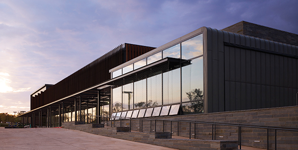 This Whole Foods market in Oklahoma City, Okla., the exterior of which was designed by Mark Cavagnero Associates, not only provides electric vehicle charging stations in the parking lot but also features a flexible seating pavilion with an adjacent outdoor terrace. Photos by Scott McDonald.