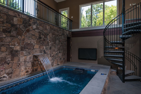 McHale Landscape Design used Weatherface fieldstone to create this sheer-descent water feature and stone accent wall. (Courtesy of McHale Landscape Design.)