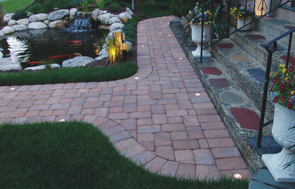 Evening Star PL250 Paver Lights in Frost were installed into the border of the walkway, staggered 6 feet apart.