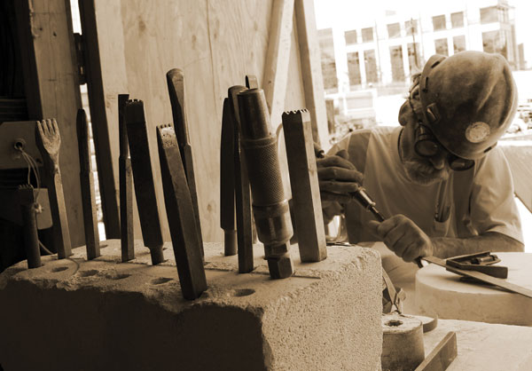 Skilled stone carvers were employed to help restore the beauty of the Capitol building.