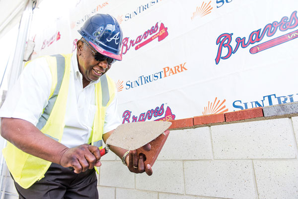 Hank Aaron also participated in the bricklaying ceremony.