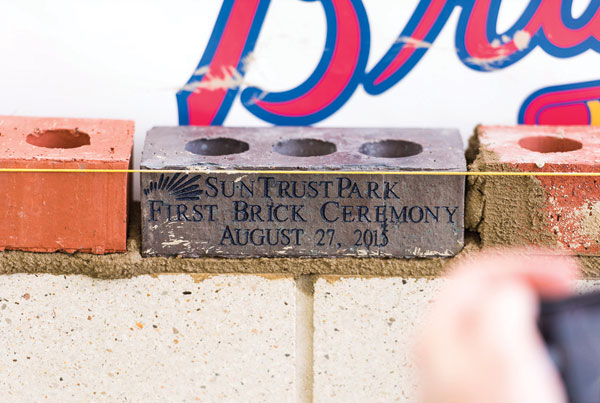 A brick commemorating the start of construction of SunTrust Park.