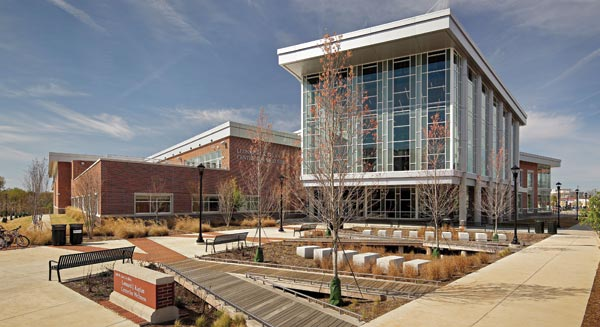 The University of North Carolina at Greensboro's Leonard J. Kaplan Center for Wellness successfully integrates brick with precast stone elements, wood, metal panels, an aluminum-framed storefront and curtain wall systems for an industrial feel.