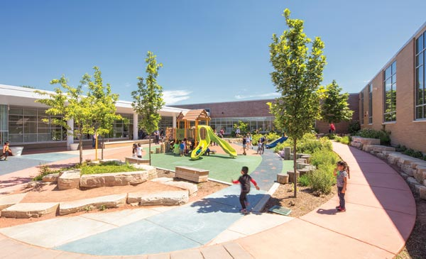 The central courtyard at the CCSD59 ELC. The brick façades of higher masses (e.g., offices, multipurpose space) tie in with the adjacent middle school. Photo © AJ Brown Imaging