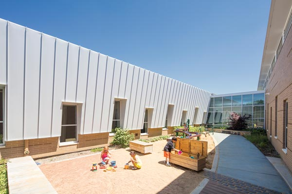 A sensory garden is one of three learning gardens at the CCSD59 ELC. Note the brick at the base of the metal wall and darker striations within the brick. Photo © AJ Brown Imaging